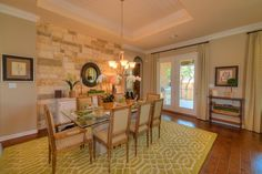 Stone wall in the formal dining room. wilshire-homes.com/austin/new-homes-georgetown-tx-water-oak