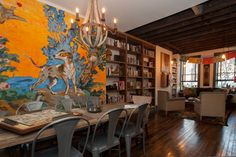 eclectic living room by Jason Snyder....Philadelphia row house....reclaimed wood floors from a Polish dance hall that was torn down