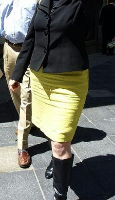 A tighter linen skirt, more horizontal wrinkles in a smaller area extending down to mid-thigh. It doesn't ride up as much when she sits, making the spacing between wrinkles tighter.