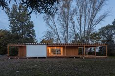 Zig-zagging roof covers Buenos Aires holiday home by Estudio Borrachia Roof Covering, Wood Architecture, Prefab, Shed, Outdoor Structures, Gallery, Outdoor Decor, Holiday, Houses
