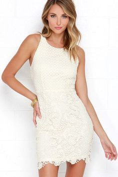 The Stage Whisper Cream Lace Dress may just steal the show! This lovely little number begins with a high, rounded neckline atop a darted bodice covered in a circular crochet lace. Swirling floral lace falls from the waist into a chic, sheath silhouette. Exposed gold zipper at back. Fully lined. Self: 90% Polyester, 10% Cotton. Lining: 100% Polyester. Hand Wash Cold. Imported.