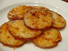 Slice potatoes thinly. Coat with small amount of butter or oil, Sprinkle paprkia and parmesan cheese on potatoes and cook until tender.