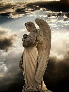Beautiful clouds behind the angel