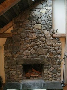 Hand-picked fieldstone with granite lintel and hearth.