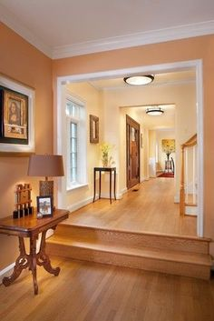 Toasty Peach/terra cotta - Benjamin Moore's Tangerine Zing is close. Looks pretty with these floors.