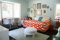 nursery daybed room  love the grey crib and the pop of orange from the daybed :)