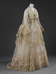 Silk gauze Quaker wedding dress trimmed with silk embroidered net lace and silk satin, British or French, 1874. Quakers in Britain varied in their approach to dress. In general they favoured mainstream styles, wishing to appear well-dressed without standing out. Lucretia Crouch adopted this course when she married Benjamin Seebohm at the Friends' Meeting House in Clevedon on September 10, 1874. Her husband, a bank manager, was a widower with a young daughter.