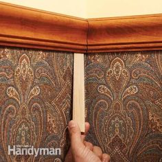 Small, hidden shims can help close gaps in chair rail corners.