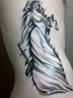 Lady Justice tattoo...I want something like this, but sexier.