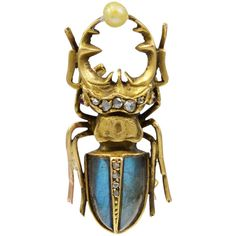 "A Gold, Rose Diamond  Labradorite Stag Beetle Brooch. A very well made model, the Stag Beetle holding a Pearl ""egg"". The Brooch is in 18kt Gold with a French mark on the pin and the body is set with a good color Labradorite and four Rose Diamonds and the thorax has a further five Rose Diamonds. The reverse of the Beetle is also well modeled. French, circa 1870"