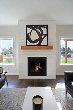 White shiplap fireplace surround with wood mantle Woodsman 11 West Coast Homes Fireplace Redo, Shiplap Fireplace, Small Fireplace, White Fireplace, Fireplace Remodel, Living Room With Fireplace, Fireplace Surrounds, Fireplace Design, Fireplace Mantels