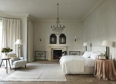 The grand master bedroom, in shades of cream and rose (one of Uniacke's cashmere blankets is draped on the bed).