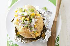 Tuna and corn jacket potatoes - 4 large sebago potatoes, 425g can tuna in springwater, 2 x 125g can corn kernels, 1/4 cup whole-egg mayonnaise, 1 green onion