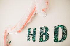 hbd sign with plastic tablecloth ruffles
