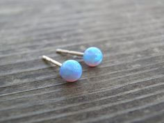 Tiny Opal Stud Earrings, Tiny Ball 4mm 14k Gold Filled Studs, Blue Opal, Gold Opal Posts, Statement Gift, October Birthstone, Bridal Jewelry by AnnalisJewelry on Etsy https://www.etsy.com/listing/165354087/tiny-opal-stud-earrings-tiny-ball-4mm