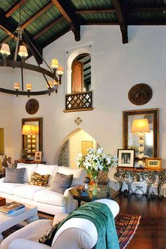 stucco walls, framed mirrors look like windows, like everything about this room, contrast, tile floor, light furniture, chandelier, beam ceiling, Spanish hacienda feel to it