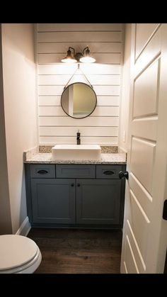 Half bathroom ideas and they're perfect for guests. They don't have to be as functional as the family bathrooms, so hope you enjoy these ideas. Update your bathroom decor quickly with these budget-friendly, charming half bathroom ideas Small Half Bathrooms, Small Half Baths, Small Basement Bathroom, Budget Bathroom Remodel, Bathroom Red, Guest Bathrooms, Laundry In Bathroom, Modern Bathroom, Bathroom Ideas