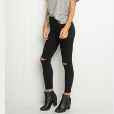 Brandy Melville Jeans - Brandy Melville black skinny jeans with knee holes