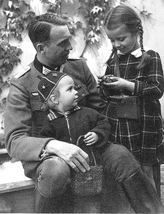 A German father visits with his children before leaving again to war (1942)