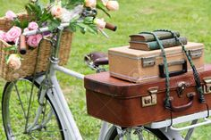 Vintage Bicycle On The Field With A Basket Of Flowers And Bag ...
