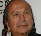 /=*(( Russell Means - Born: 1939-11-10 - Died: 2012-10-22 Cause of Death: Cancer. This dear man is mostly known for his involvement with native American rights and the American Indian Movement. He was also involved within the arts, acting in various movies, such as: Pocahontas, Last of the Mohicans, and the most recent movie of Pathfinder. Also recorded an album called Electric Warrior, and published an autobiography titled Where White Men Fear to Tread.