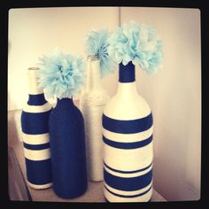 Yarn-wrapped wine bottles with tissue paper flowers! Wine Bottle Glasses, Wine Bottle Art, Diy Bottle, Wrapped Wine Bottles, Empty Wine Bottles, Paper Flower Decor, Paper Flowers, Yarn Bottles, Decorated Wine Glasses