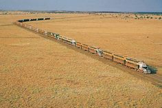 But imagine finding yourself behind one of these enormous beasts. This is an Australia road train comprising a very powerful truck, or tractor, pulling three and sometimes even four trailers at a time.