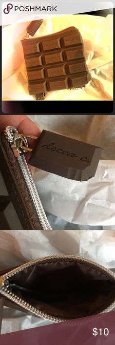 Chocolate Wallet NWOT This is a wallet disguised as a chocolate bar 😉 It looks like a chocolate 🍫 bar and SMELLS like a chocolate bar (REALLY!). NWOT tag. I bought this for a benefit (and because I really like chocolate!!). Never used. Perfect for slipping your must have ID/cards, some change, then clip it to your key chain. Voila your good to go to without carrying your big purse. Nice 🎁 for the chocolate lover in your life. Don't forget Valentines Day! decca c Bags Clutches & Wristlets