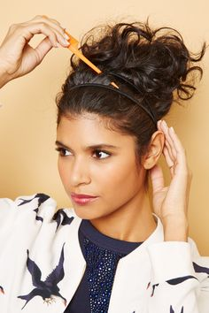 Curly Styles That Kick Humidity To The Curb #refinery29  http://www.refinery29.com/curly-hair#slide-15  Use your fingers or the end of a tail comb to gently pull up the hair between the headbands slightly.