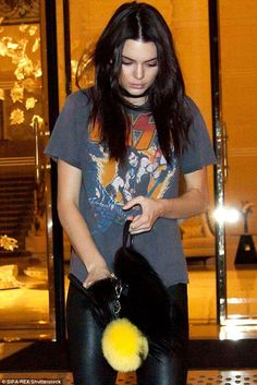 Rock chick: Kendall teamed a band T-shirt with a pair of leather trousers for dinner at Kinu Restaurant on Sunday evening
