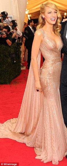 I WILL NEVER GET ENOUGH OF THIS LOOK: Best dressed @ 2014 Met Gala | Blake Lively in a custom Gucci Premiere silk blush gown embroidered with rose-gold paillettes and a chiffon cape