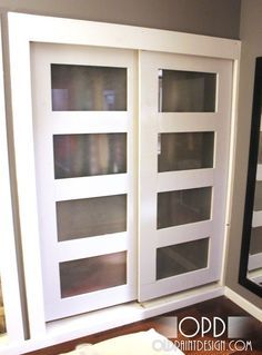 DIY sliding closet doors. These are very very similar to what I was planning for our bedroom remodel this winter. However I'm going to use stained glass panels rather than frosted glass. And I will be routering a rabbit into the back to attach the glass, rather than using glue and mirror clips.