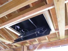 I've always thought that flip down TV mounts were cool, and have long looked for an opportunity (or excuse) to build one. A couple of years ago, we built a boathouse. Tv Ceiling Mount, Ceiling Tv, Outdoor Tv Cabinet, Tv Options, Underground Bunker, Outside Patio, Covered Decks, Diy Tv, Mounted Tv