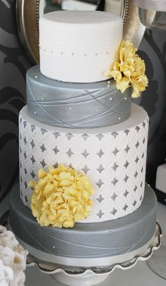 Metallic Silver and Yellow Wedding Cake  -  What about with orange and columns with the white and silver?