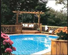 Above Ground Pool Ideas Backyard this raised deck sits on the far end of an oval above ground pool Above Ground Pool Deck With Pergola
