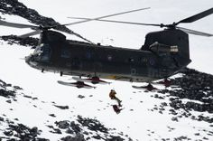 A search and rescue crew member from Joint Base Lewis-McChord repells out of a Boeing CH-47D Chinook during rescue training May 21 on Mount Rainier. DANIELLE GREGORY — Northwest Guardian