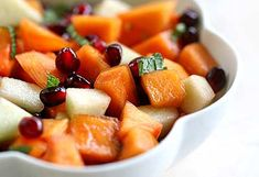 Refreshing fruit salad with persimmons and pomegranates