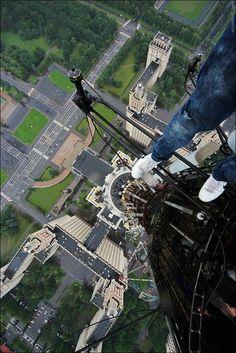 Russian Daredevil Takes Vertigo-Inducing Photos Of Himself Hanging Off Buildings - DesignTAXI.com