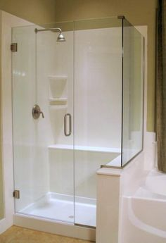 nice white on white cultured marble shower with frameless door