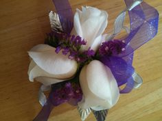 White Rose wrist corsage with purple and silver accents.