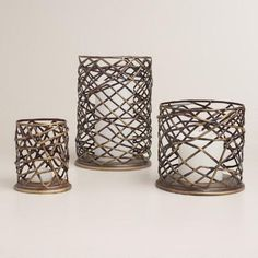 Bring a rustic note to your tabletop decor with our candleholder, available in three sizes. It's handcrafted of metal in an industrial-inspired woven design.