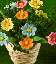 "Wicker Basket of Mini Pastel Flowers, 1.6"" tall x 1½"" wide.  From Enchanted Gardens, $6.50 ea"