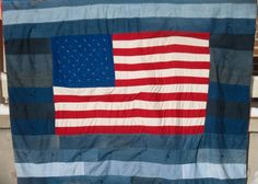 This queen size quilt is crafted primarily from upcycled denim.  The flag in the middle is cotton.  The flag measures about 30 inches by 50 inches.   Each denim strip is about 5 inches wide. Since this quilt can be made to order, you have many customizeable options. As pictured, the back of the quilt is a red flannel, but you may choose flannel or cotton in any color you wish. The layers of the quilt are joined together to prevent bunching and shifting.  The quilt pictured has been hand tied…