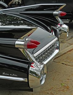 CADILLAC with big fins! My back seat play ground!