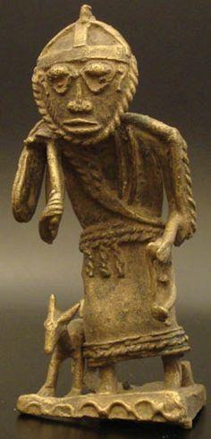 Type of object: Brass figure Country of origin: Africa Measurement: 5.5x 4.5x 12x (cm) Materials: Brass