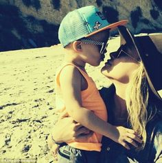 Locked in time: Actress Hilary Duff received a sweet kiss from two-year-old son Luca on a Mother's Day stroll on the beach in Malibu