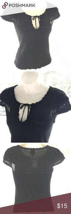 Crochet knitted Black top Black crochet detailed top. Very cute to give a feminim touch to any out fit. It is very light weight knitted with a little stretch to it. I love the skin showing through those crochet holes, really nice👍 Tops