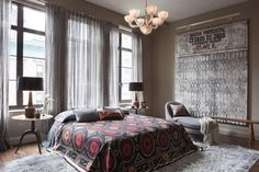 gray room with Suzani coverlet