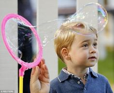 George ran around with other children enjoying the attractions - from balloon sculptors to a petting zoo - as the Duke and Duchess of Cambridge watched