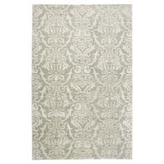 Beautifully hand-knotted from New Zealand wool and art silk, this damask-print rug brings elegant style to your living room or master suite....